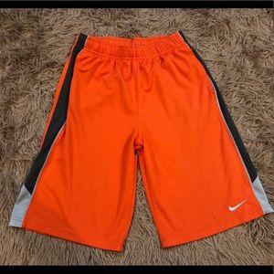 Nike orange basketball shorts